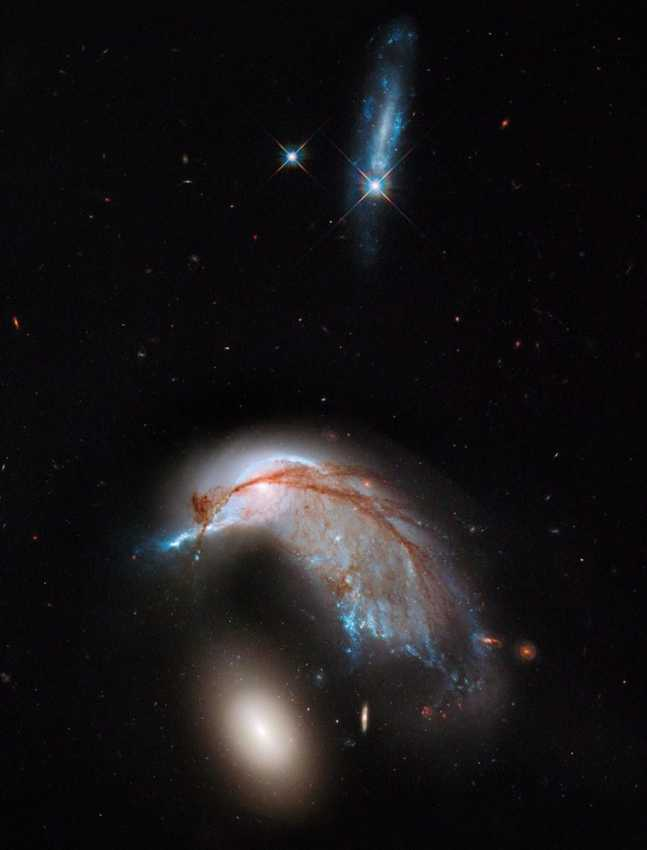 NASA Hubble Space Telescope image of an interacting galaxy duo,  collectively called Arp 142