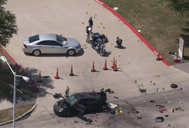 The car that was used the previous night by two gunmen is investigated by local police and the FBI in Garland Texas