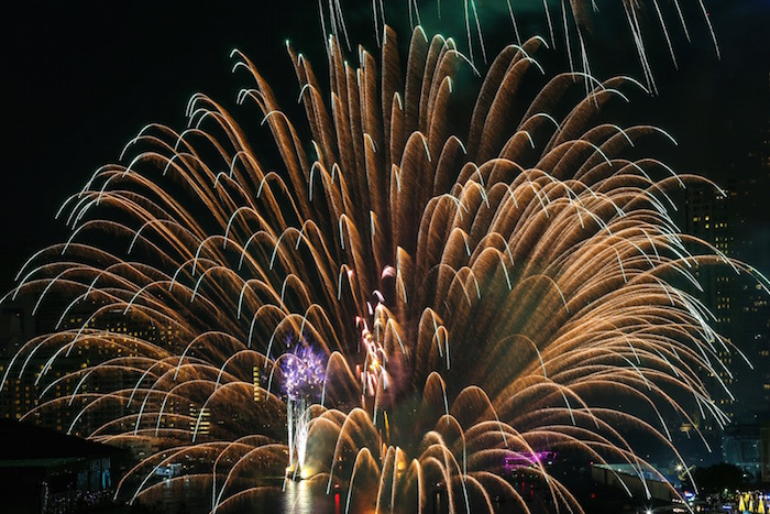 Fireworks explode over Chao Phraya River during New Year's celebrations in Bangkok