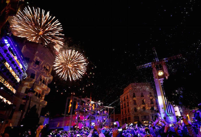 People watch fireworks in the rain on New Year's Day in downtown Beirut, Lebanon