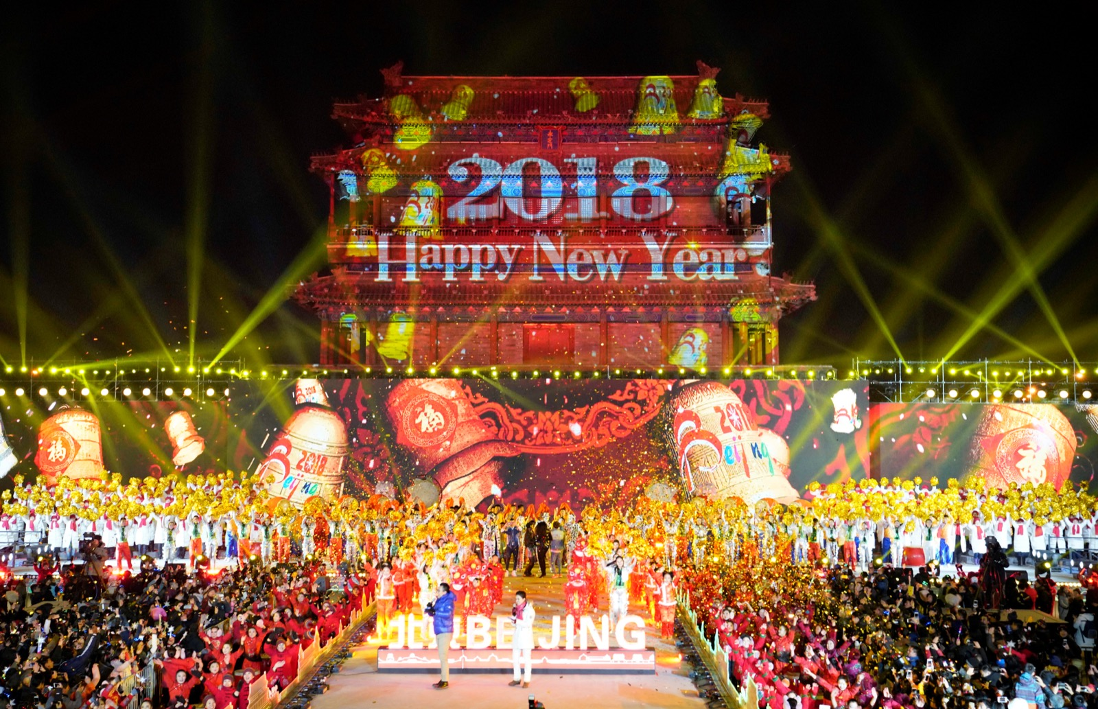 People celebrate the new year during a countdown event at Yongdingmen Gate in Beijing
